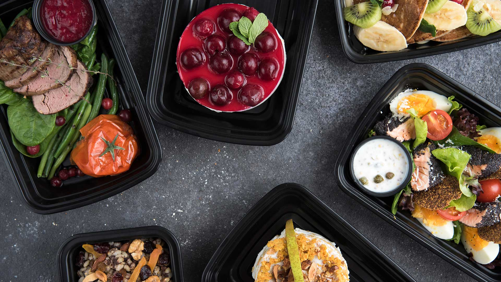 Healthy meal box on black top