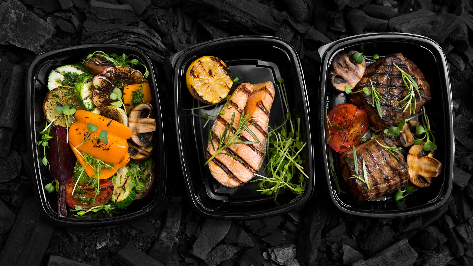 healthy meal box on charcoal